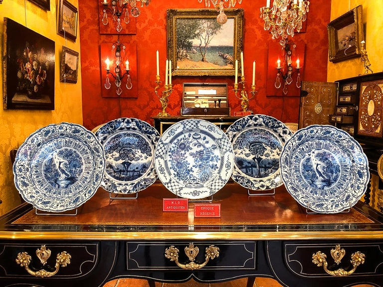 Sign by Ax, mid-18th century, Magnificient Faience delft round dish  A magnificent and rare delft faience plate, hand painted in a blue cameo, depicting peonies. Our plate signed on the backside in blue with the sign of the manufacture Ax, under