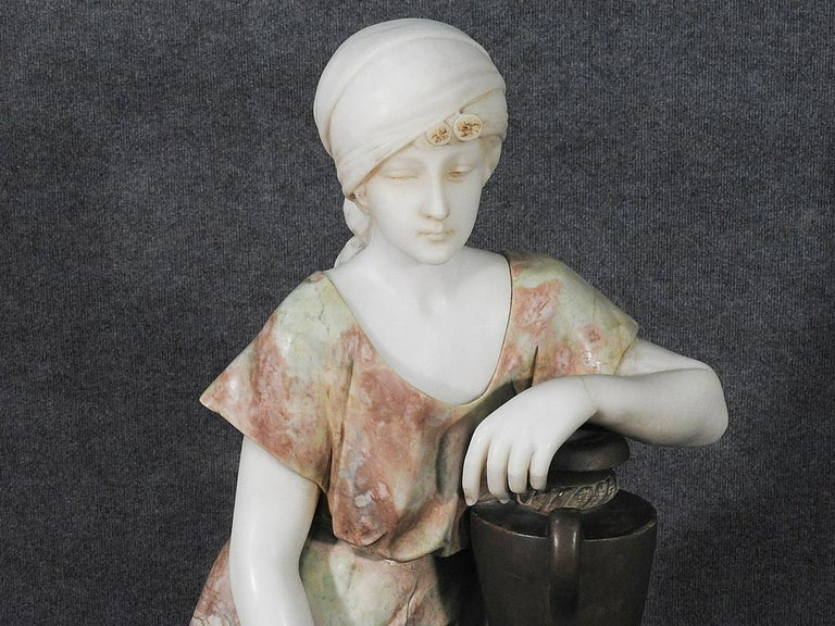 This is a fantastic Adolfo Cipriani, a very well-known Italian sculptor who did particular sensitive sculptures of young women with various poses and scenes. This piece is one of the finest we have ever had by this sculptor and is very large and