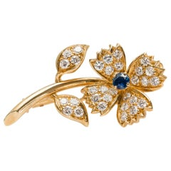 Signed Boucheron 1960s Flower Pin with Blue Sapphire and Diamonds in 18k Gold