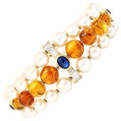 Signed Boucheron Akoya Pearl, Amber, Sapphire and Diamond Bracelet in 18k Gold
