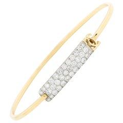 Signed Cartier 18 Karat Yellow Gold and One Carat Diamond Bangle