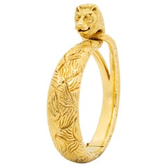 Signed Cartier France 18 Karat Yellow Gold Engraved Lion Bangle