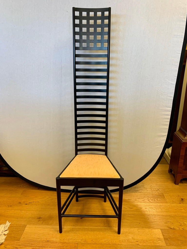 Elegant signed Cassina Charles Rennie Mackintosh Hill House chair. This tall ladder back chair has become a design classic over the years. . The frame is made out of black stained ash wood and the seat cushion is a peach velvet. All manufacturer