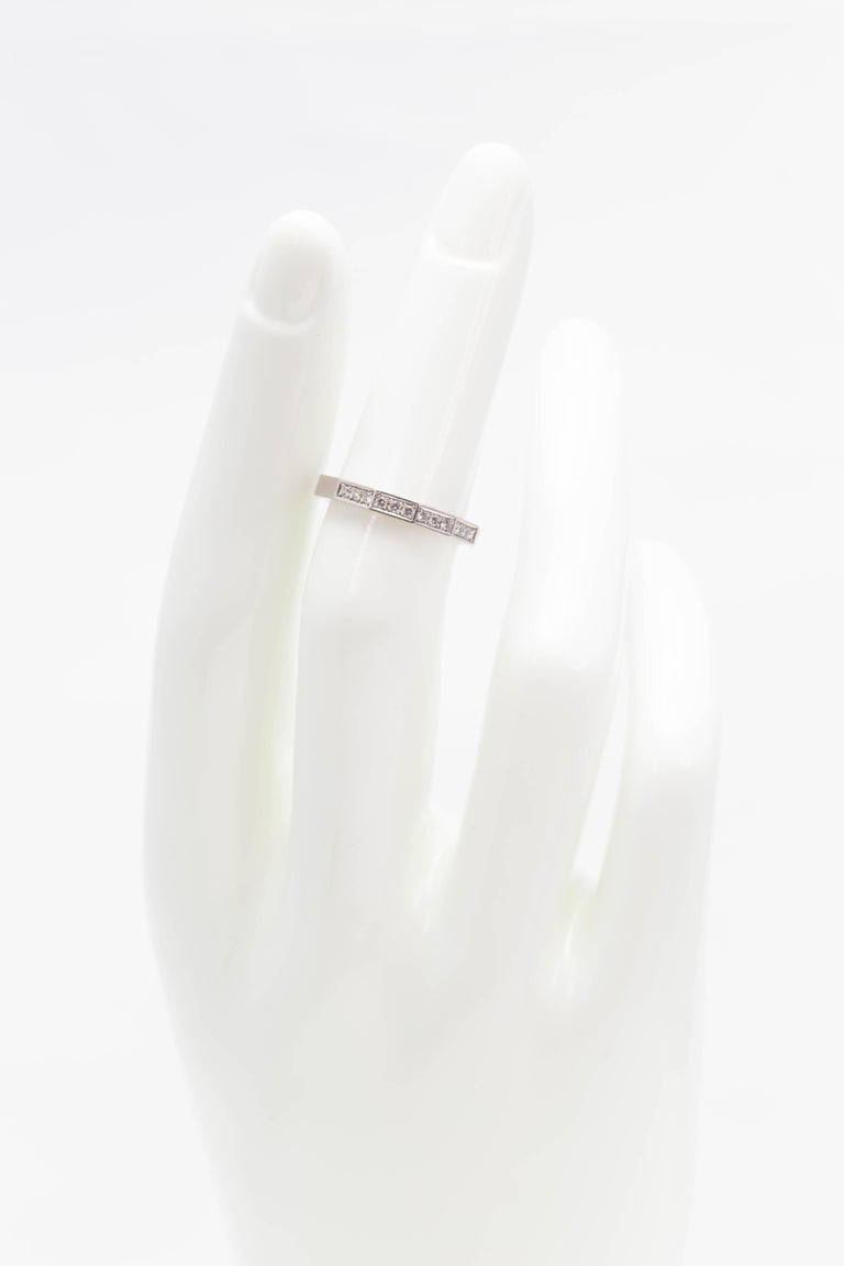 A signed Celine European octagonal half Diamond and platinum wedding band ring circa 1990, size 5. Made in Europe during the later years of the 20th century, this wedding ring features an octogonal shape, adorned with full cut round Diamonds of a