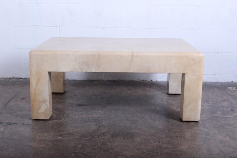 A signed coffee table in goatskin by Karl Springer.