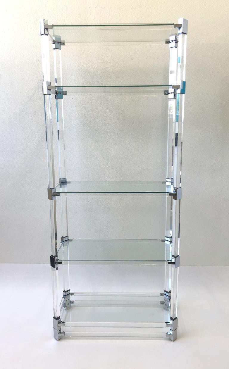 A glamorous clear acrylic and polish chrome with glass shelves étagère design in 1973 by renowned American design Charles Hollis Jones for Paul Laszlo. The étagère is in original condition, so it shows minor wear. The étagère is signed and dated by