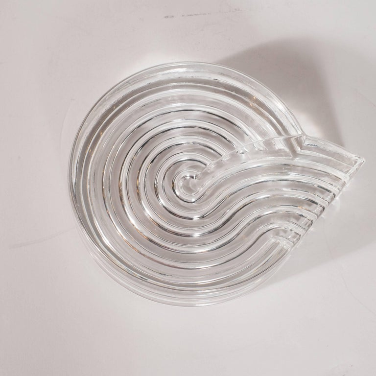 This stunning piece was created by Natale Sapone for Rosenthal- the esteemed German glass studio, circa 1980. Realized in an Art Deco revival aesthetic, this ashtray/side dish features a whirlpool form, consisting of various channels etched on the