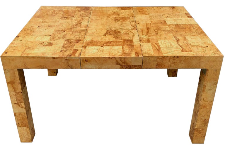 Top of the line handcrafted burlwood table. Other designers produced burl Parsons tables such as Milo Baughman and Leon Rosen however, Paul Evans added his signature patchwork design that really stands out above the rest.  A nice size that could