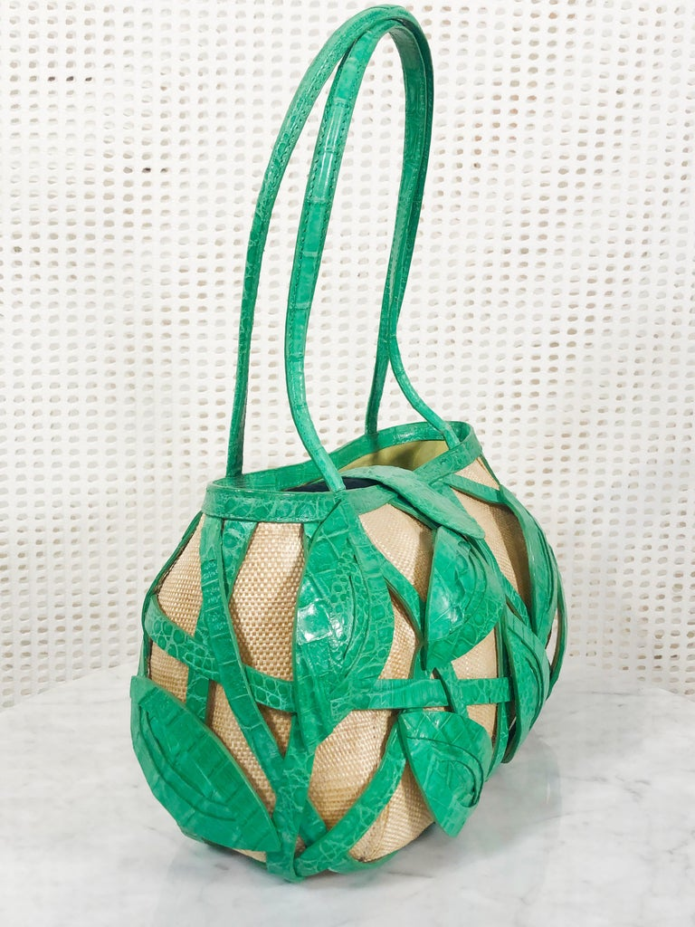 A very special one of a kind hand-signed Nancy Gonzalez woven straw and textured green crocodile