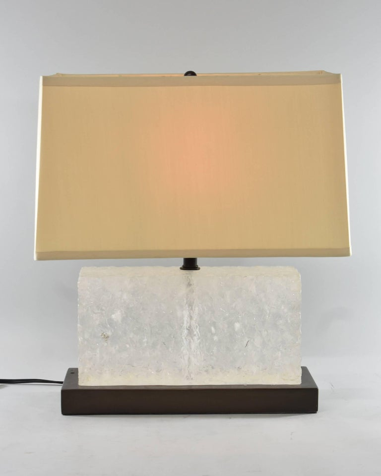 A splendid carved ice table lamp by Robert Kuo for McGuire, signed and numbered 3/19. This beautiful lamp features a hand-carved natural rock crystal on a copper base with a pongee silk shade that contrasts with the lamps unique materials.
