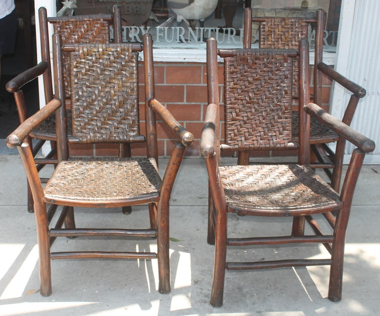 Signed old hickory arm chairs in amazing old surface in fantastic condition. These chairs have such an amazing undisturbed surface and are signed on the lower back legs: Old Hickory Furniture Company, Martinsville, Indiana. Some have the little