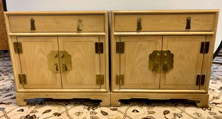 A gorgeous matching pair of nightstands by Ray Sabota for Century Furniture Company, circa 1970s. Brass hardware and lovely motifs accent the pieces. Excellent vintage condition. Retains the maker mark and Sabota label as well.