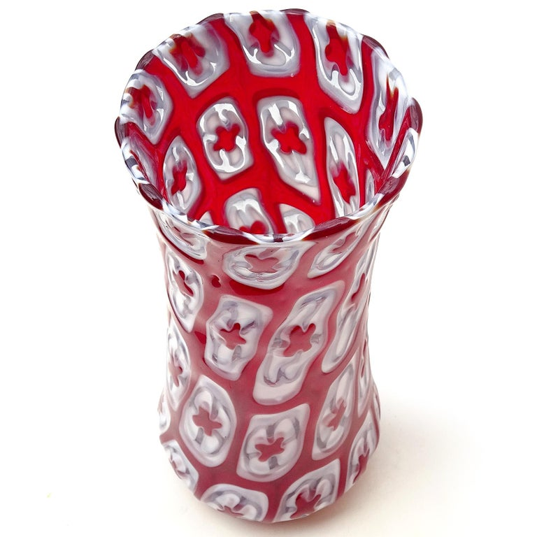 Beautiful hand blown red and white Millefiori studio art glass mosaic flower vase. The piece is made with large murrines blown together. You can feel each flower with your fingers on the surface. It is signed underneath with letters and numbers.