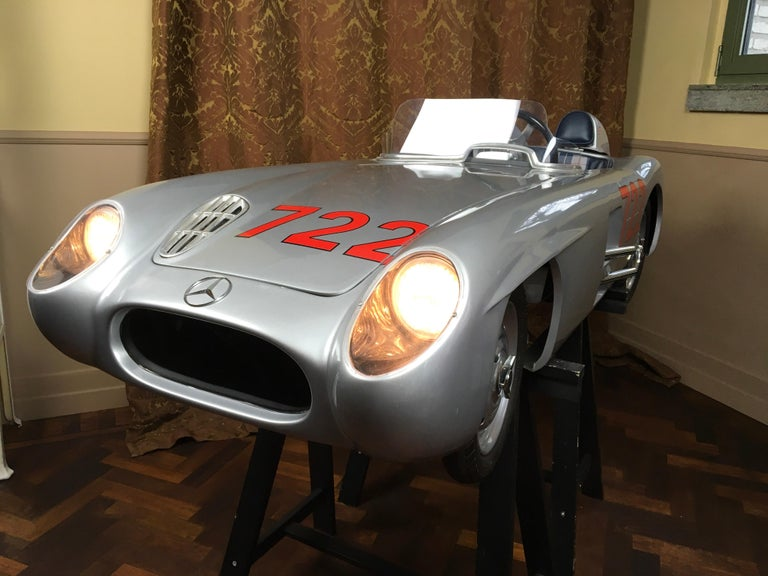 Exceptional 1/2 Scale handmade Electric Mercedes-Benz 300 SLR Junior Car.  This 722 Racer Half Scale Kids Car has number 004 / 005 and is signed by Sir Sterling Moss , the legendary Race Pilote that drove Victory in the 1955 Mille Miglia with this