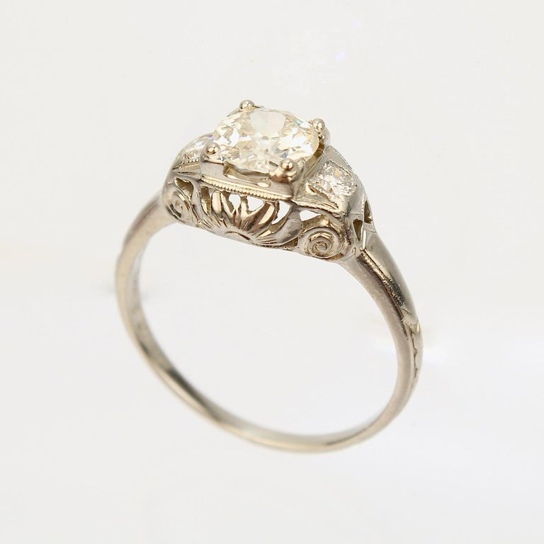 A very fine antique Art Deco Orange Blossom diamond ring.  In 18k white gold with a fine decorative filigree bridge.  Orange Blossom rings are highly desirable and coveted by collectors!  Made by the Traub Manufacturing Co.  The lovely central