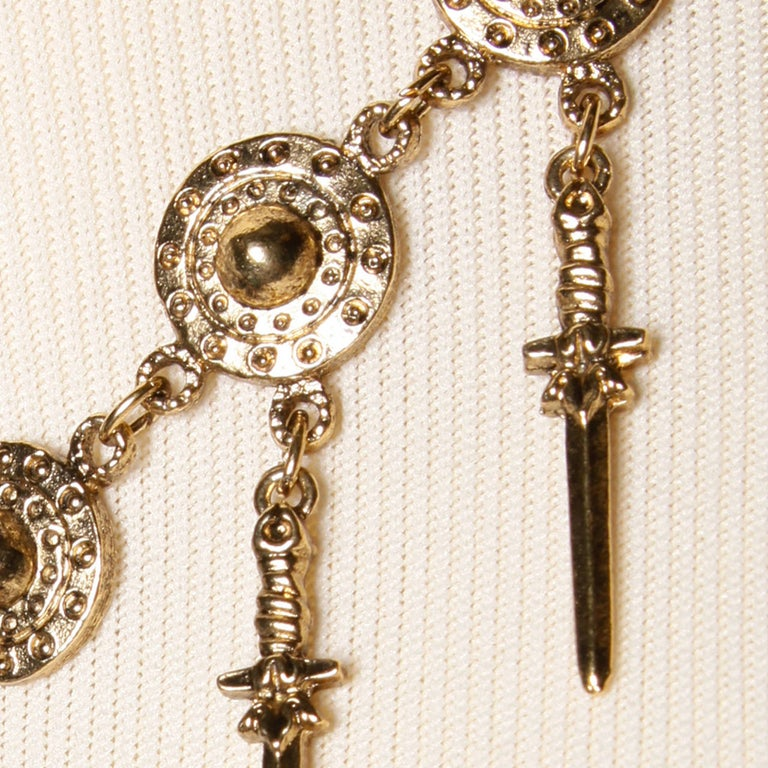 Modernist Signed Trifari 1970s Gold Tone Viking Runway Necklace with Swords + Shields For Sale