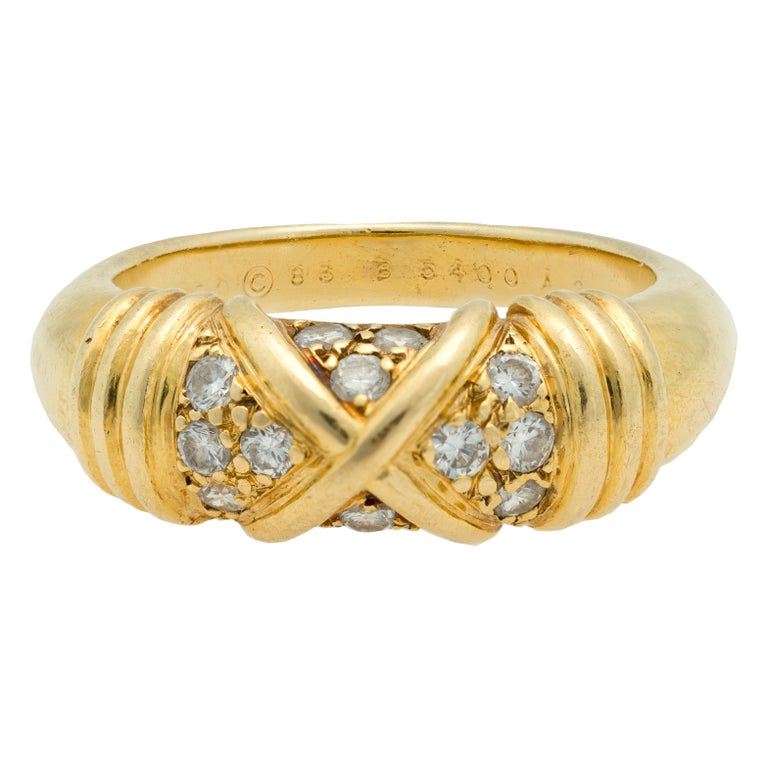 A signed Van Cleef & Arpels Diamond band ring in 18K yellow gold, size 6 ½. Made in France during the 1990s, this signed Van Cleef & Arpels band ring features full cut round Diamonds with a total weight of 0.28 carats and of F color and VVS- VS