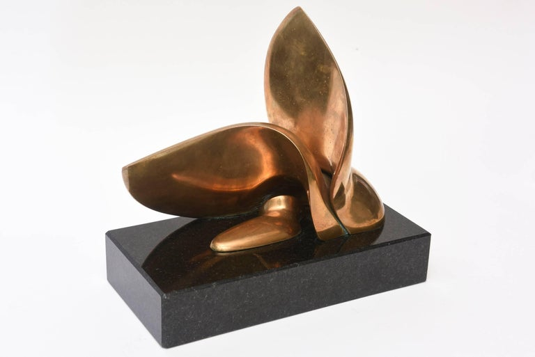 This amazing bronze biomorphic sculpture that is signed Zajac 15/25 sits on a thick granite base. it is bolted in as per the sculptor's intentions. The black granite base is 2.25