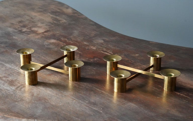 A set of four adjustable / modular candlesticks / candleholders / candelabras. Designed and produced by Swedish / Finnish silversmith and designer Sigurd Persson (1914-2003). Labeled. Named