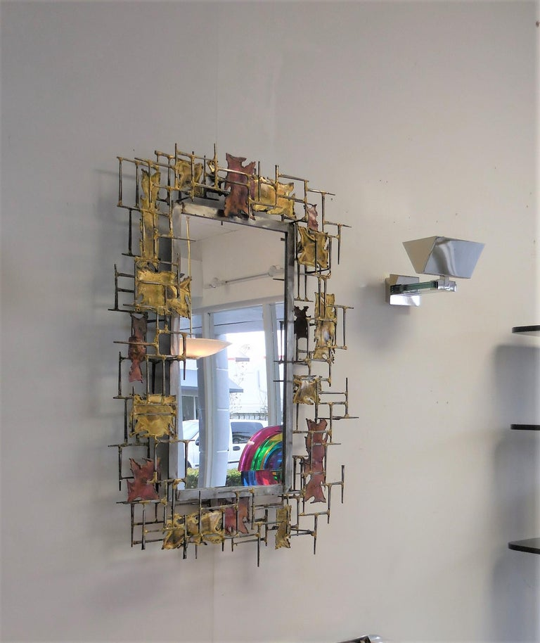 A large and rare sculptural mirror by Silas Seandel. The frame is open and tri-dimensional. The effect is bold and somehow delicate. Signed and dated, 1977.