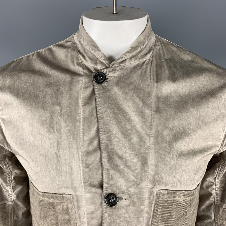 SILENT by DAMIR DOMA jacket comes in a taupe distressed cotton blend featuring a notch lapel style, two oversized canvas patch pockets, elbow patches, and a buttoned closure.   Very Good Pre-Owned Condition. Marked: L   Measurements:   Shoulder: