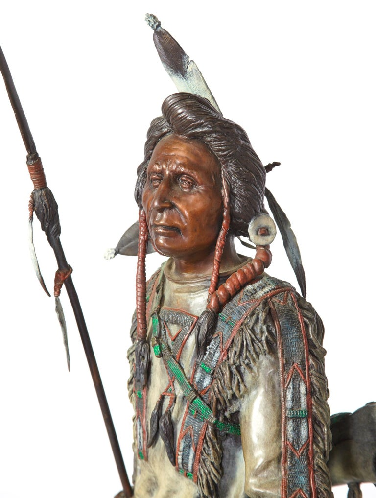 'Silent Sentinel' circa 1996 is a painted bronze figure by James Regimbal depicting a strong and self assured Indian warrior. This powerful piece is in excellent condition and stands 30