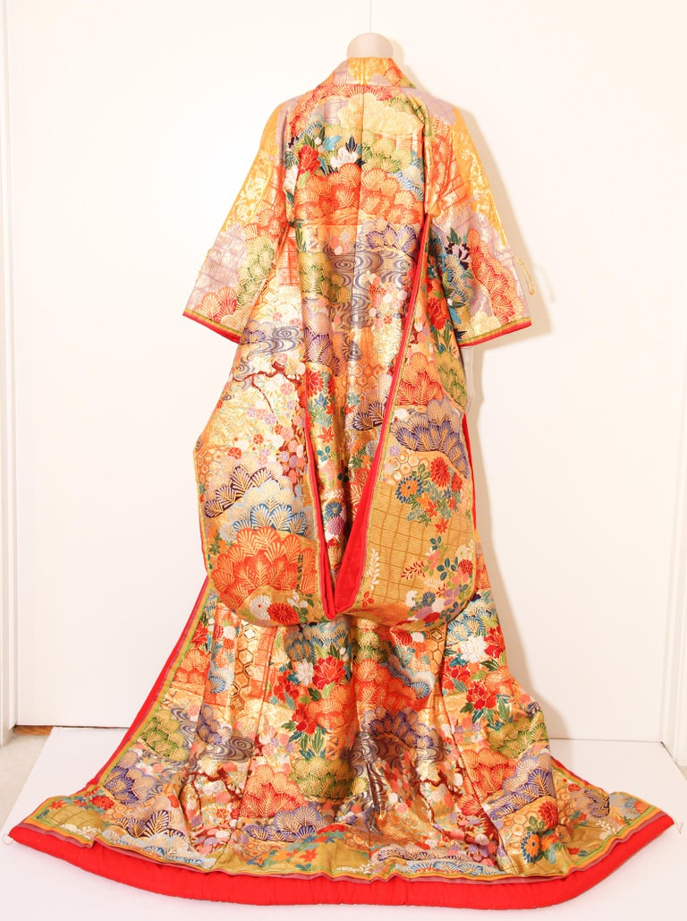 A vintage color silk brocade collectable Japanese ceremonial wedding kimono.  Vintage heavy, signed by the maker, one of a kind handcrafted. Fabulous museum quality ceremonial piece in pure silk with intricate detailed hand-embroidery throughout,