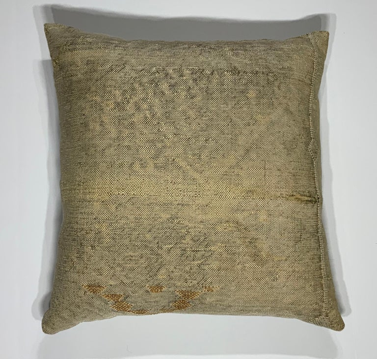 Beautiful pillow made of handwoven flat-weave rug fragment, cream camel color with geometric motif, silk backing, fresh down and feather insert.