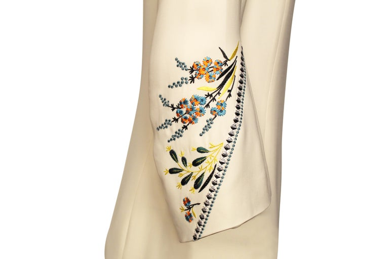 Silk Christian Dior mini dress with colorful embroidered flared sleeves. Size 34.