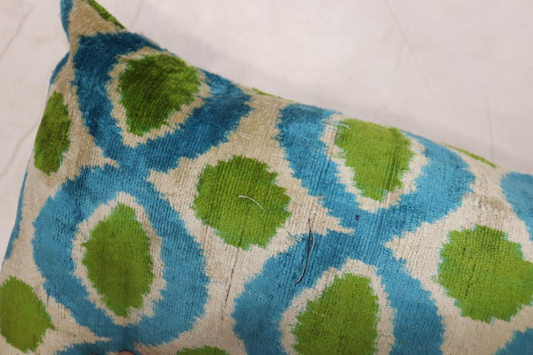Pillow made from a silk Ikat pillow. zipper closure and poly-fill insert provided.  Measures: 14'' x 24''.
