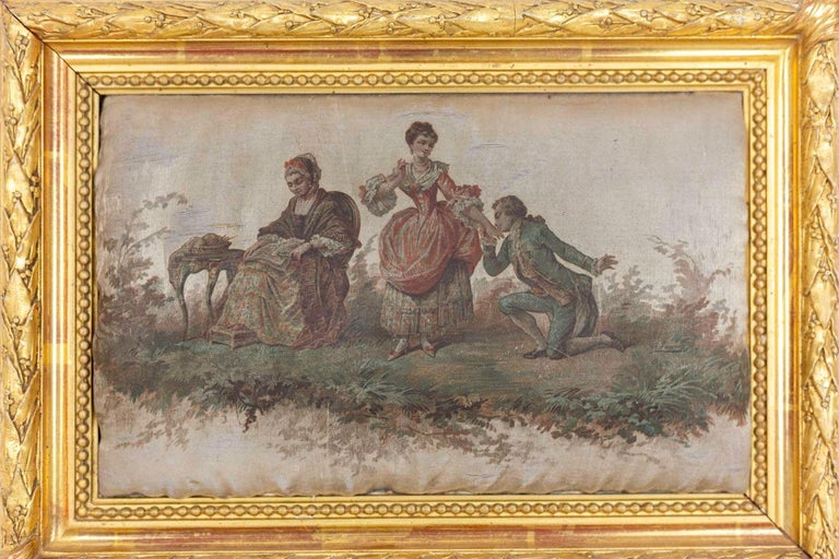 Small silk printing figuring a romantic scene in the 18th century style. A stand woman wearing a red and white dress reaches her hand to kiss to a kneeling man in front of her who wears a green jacket and trousers. An older woman is sitting next to