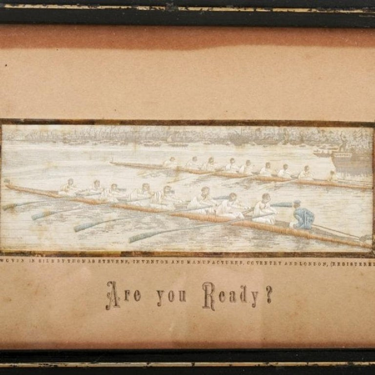 A Victorian woven silk Stevengraph of a boat race.  The picture is at the start of the race with the starter on a tender holding a starting pistol,