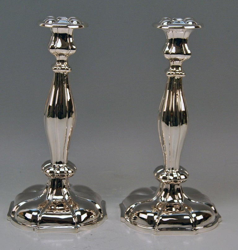 Austrian excellent Biedermeier silver pair of candlesticks, made 1857.  Very interesting Viennese silver pair of candlesticks of finest manufacturing quality as well as of elegant appearance. These candlesticks were made during Viennese late