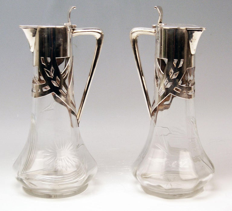 Pair of Art Nouveau Glass Decanters (Carafes / Jugs) with Silver Mountings   Marks: -- Walking Lion of Firm Deyhle Brothers, Germany / Schwaebisch Gmuend (= manufactory founded 1820)  -- branded by German Crescent with Crown, used as from year