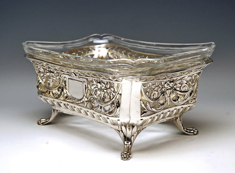 Silver nicest flower bowl / centrepiece with original gorgeous glass liner Total width: 26.5 cm ( = 10.43 inches)  decorative style / transition to Art Nouveau  made circa 1900  Hallmarked: -- SILVER 800 -- branded by German Crescent with