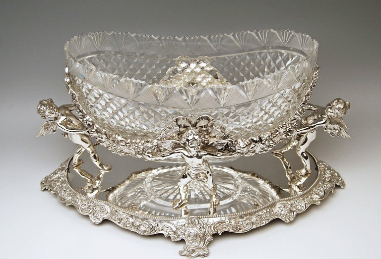 Silver German huge flower bowl / centrepiece with original gorgeous glass liner Measures: c (18.30 inches)   Style of Historicism / Neo-Baroque (made circa 1888-1890)  Silver 800 branded by German Crescent with crown (used as from the year 1888 as