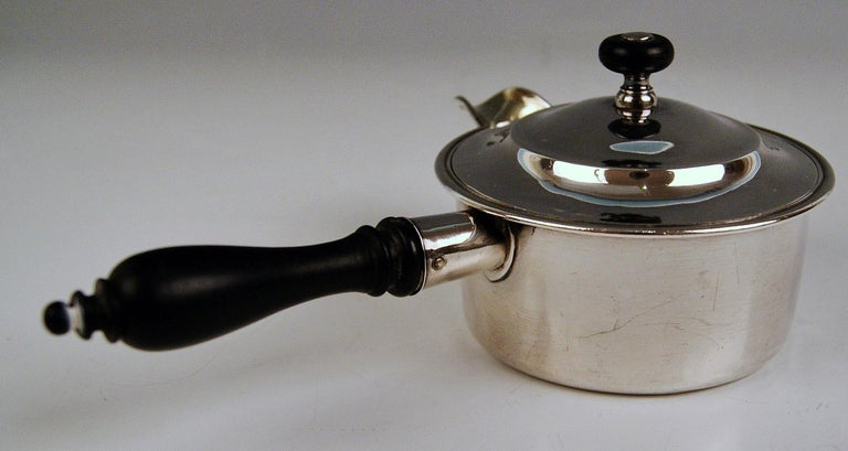 Most Elegant Lidded Caster / Founder Made Of Silver 875 (84). This lidded caster is round shaded, having a spout and a rod-shaped handle consisting of black stained wood. Additionally, the lid is topped by knob and the caster having smooth surface