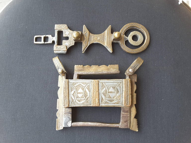 A silver and bronze camel chest lock 19th century, North Africa, bought in Tunisia in the early 1960s directly from Nomads. The lock was used to lock valuables in chests which were then packed on camel caravans for travel. The lock is bronze and