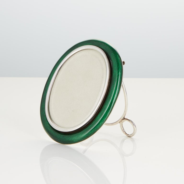 A rare early 20th century silver and enamel photo frame of exceptional quality. The frame is the smallest of the frames in the images.  The silver and translucent Guilloche enamel is of highest quality. Date circa 1910-15, Origin Austria.