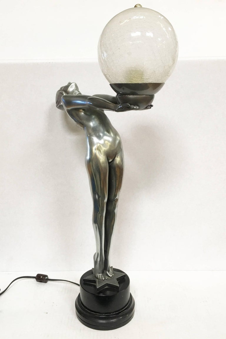 Silver Art Deco style nude biba lamp on a stepped base fashioned after