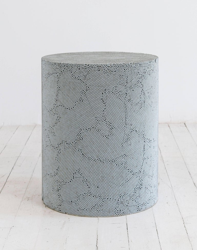 Composed from silver BB pellets, this made-to-order drum has a hollow cavity and consists fully of silver ammunition, creating a hypnotic camouflage of texture and smoothness. The piece has a hollow cavity and weighs approximately 90lbs.