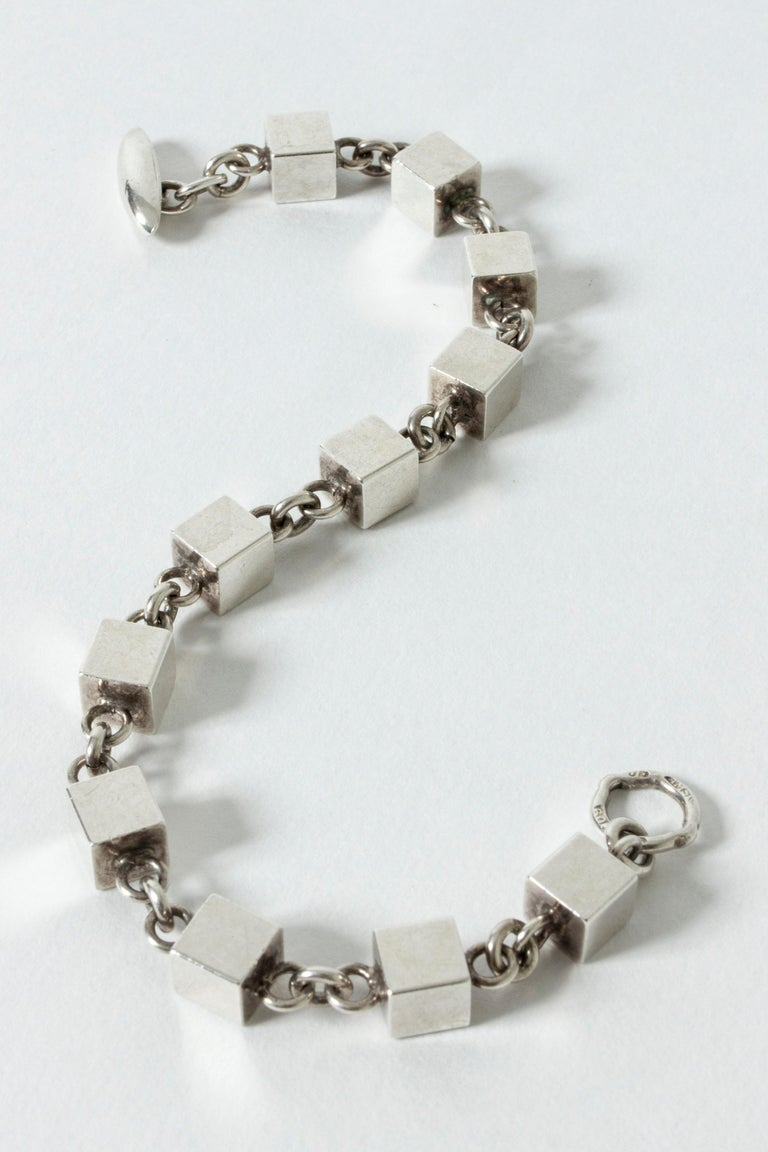 Very elegant silver bracelet by Arvo Saarela, made from numerous interlocking cubes. Solid cubes, weighty quality. Nice contrast with the neat chains.