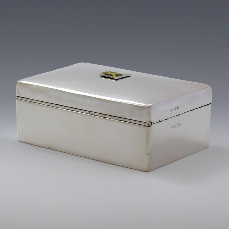 Fine Sterling silver cigarette box with enamel flag to the top showing a field of black with a yellow saltire. Original cedar lining to the interior. Hallmarked London 1935 and engraving with the retailers name, 'Sorley, Glasgow' to the
