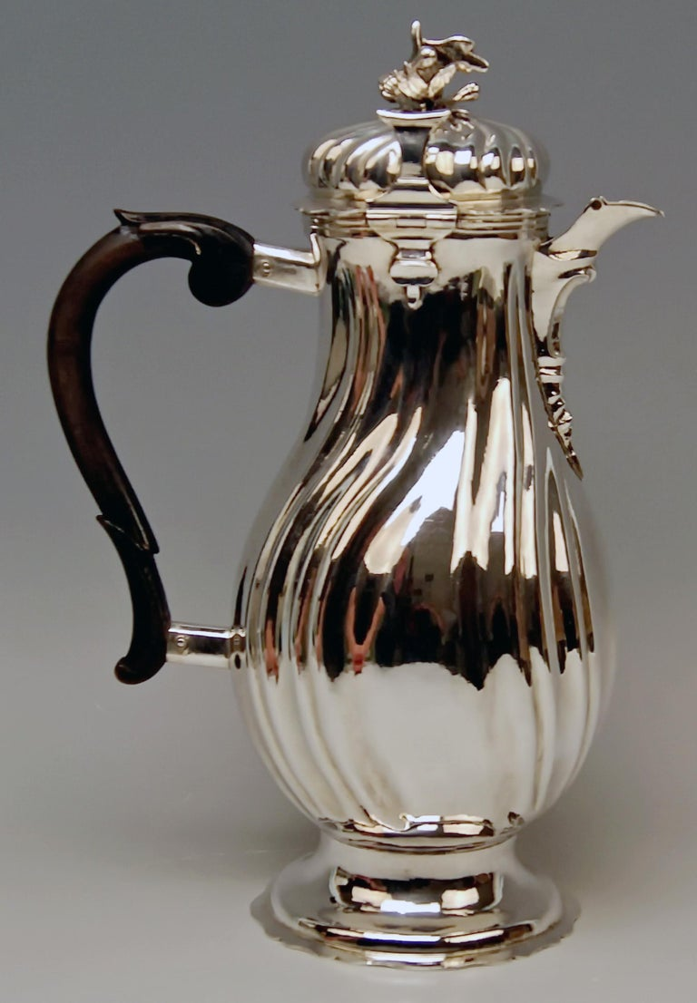 Gorgeous Coffee Pot of Rococo Period / form type: pear.  Made in Augsburg 1775-1777 Jakob Wilhelm Kolb (born c. 1743 in Stuttgart/Germany - died 1782) / he became master in year 1768.  Specifications: Made of silver / finest manufacturing