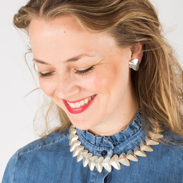 Exquisite silver collier from Stigbert, in heavy silver quality. Made from concave, flower petal like segments that lies nicely around the neck.