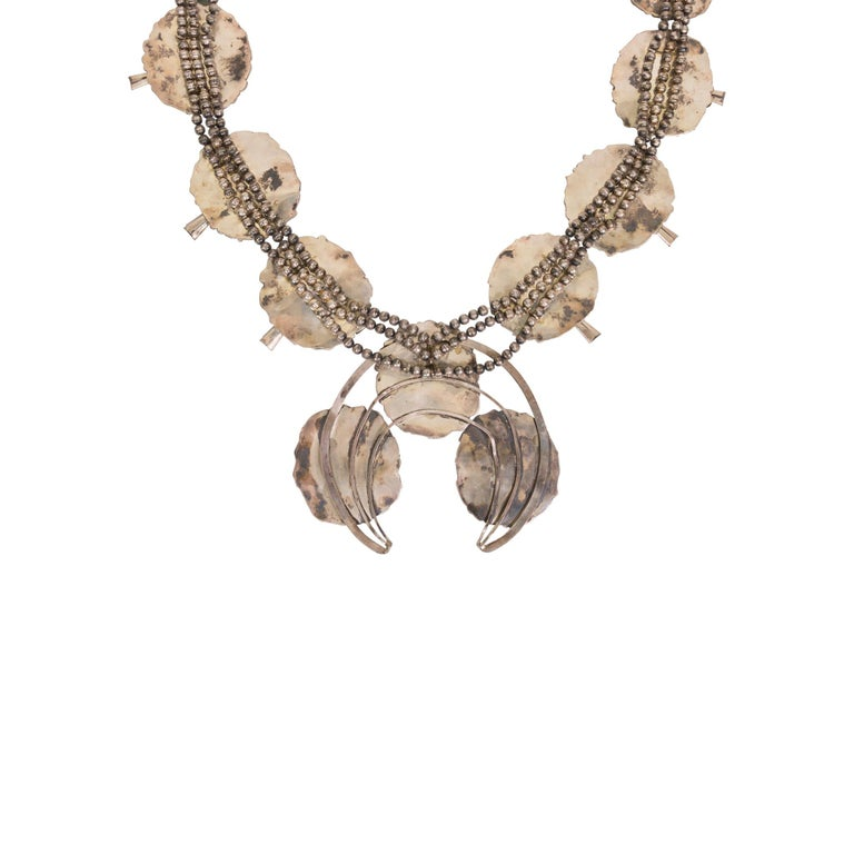 Exceptional Navajo silver dollar squash blossom necklace. Crafted in 1925 for a special occasion/pow wow. Eleven 3