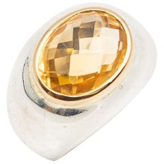 Silver Dome Ring Topped with a Faceted Citrine and Gold Bezel
