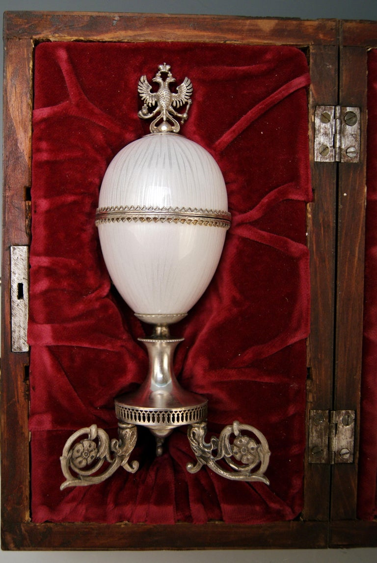 Silver enamel Czar Nicholas II Egg Moskow Russian Empire, 1894  It is an egg made of enamel and decorated with silver mountings consisting of: - Russian Imperial Eagle at top - hinge - silver locket depicting portrait bust of Czar Nicholas 2nd
