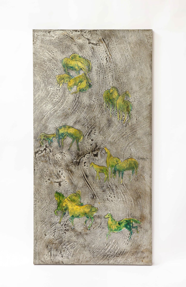 A fantastic and quite rare acid etched metal panel of green iridescent horses on a silver ground, Signed Philip and Kelvin LaVerne. This is one of the rarer signed LaVerne pieces, due to its size, unusual design, and beautiful vibrant colorway.