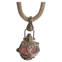 Silver Harmony Ball Pendant with Rose Quartz Ball and Garnet Accent